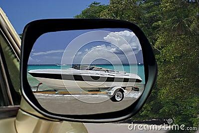 Car & speedy boat on paradise beach.