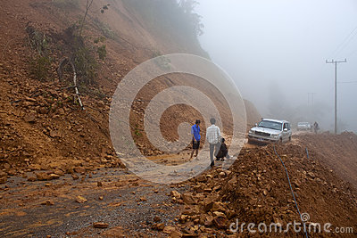 Car stuck in a  landslide Editorial Stock Photo