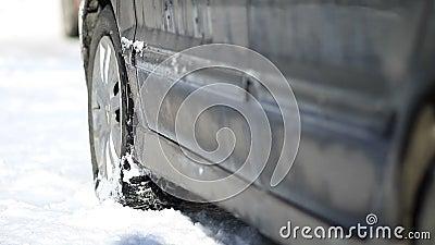 Car stuck in snow in wintertime stock footage