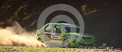 Car throwing dust and rocks Editorial Photo
