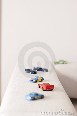 Car toys on a sofa