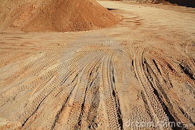 Car track in the sand