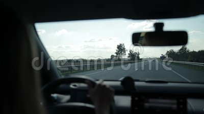 Car traveling on asphalt highway on sunny day stock video footage