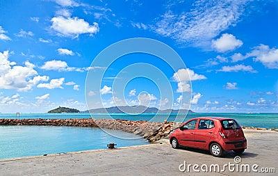 Car on tropical beach