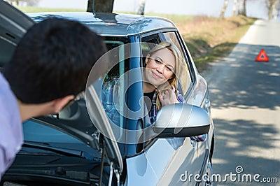 Car troubles man help woman defect vehicle