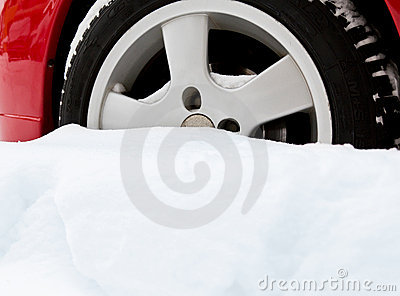 Car wheel bogged down in snow