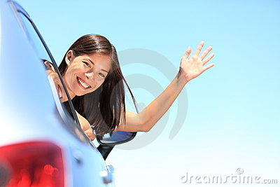 Car woman happy on road trip travel