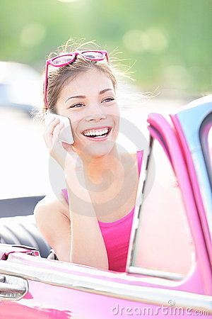 Car woman talking on phone on vacation road trip