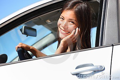 Car woman using smart phone