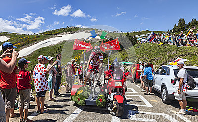 Caractère drôle sur la bicyclette Photo éditorial