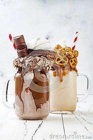 Free Caramel And Chocolate Crazy Freakshake, Milkshakes With Brezel Waffles, Popcorn, Marshmallow, Ice Cream And Whipped Cream. Stock Image - 95245141