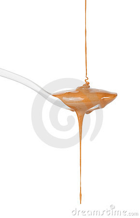 Free Caramel Sauce Dripping On Spoon Stock Photography - 17423472