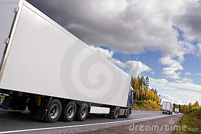 Caravan of trucks on highway
