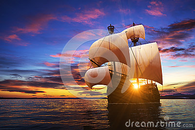 Caravel On The Sunset Background