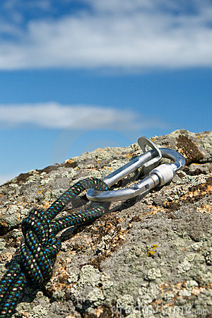 Carbine and rope on rock