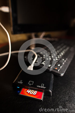 Free Card Reader Plugged To The Black Computer Stock Photos - 36769113