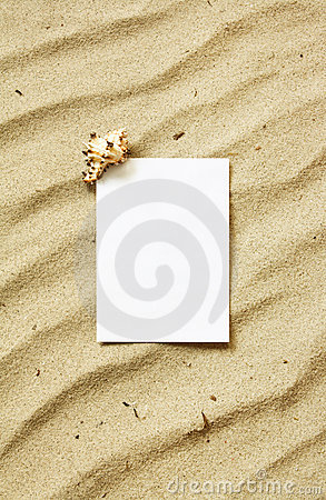 Card on sand with sea shell