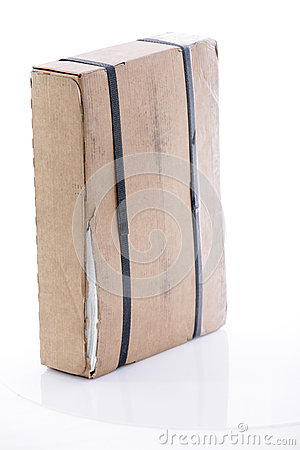 Cardboard box strapped with tape