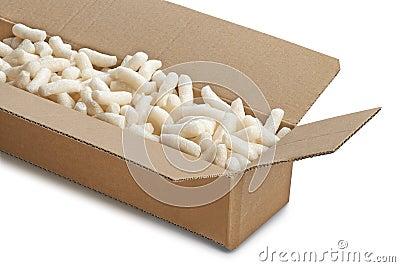 Cardboard box with yellow packing styrofoam peanuts