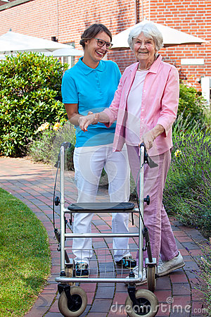 Free Care Assistant Helping An Elderly Lady Stock Photo - 44681260