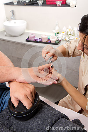 Care of man nails and manicure in beauty center