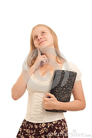 Carefree businesswoman holding laptop