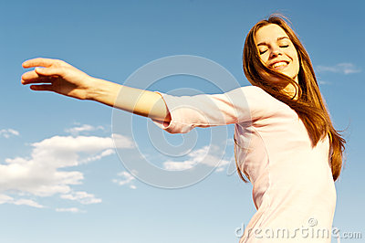 Carefree girl and blue sky