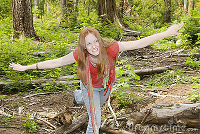 Carefree girl having fun in forest