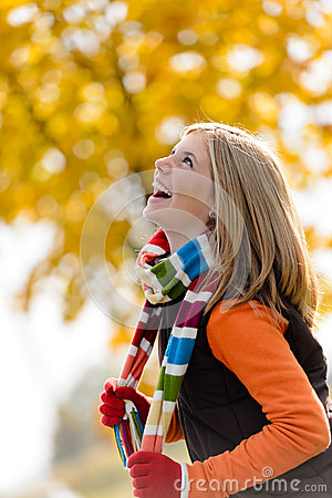 Carefree laughing young blonde girl autumn forest