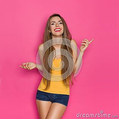 Free Carefree Smiling Girl In Orange Shirt Royalty Free Stock Image - 77384976