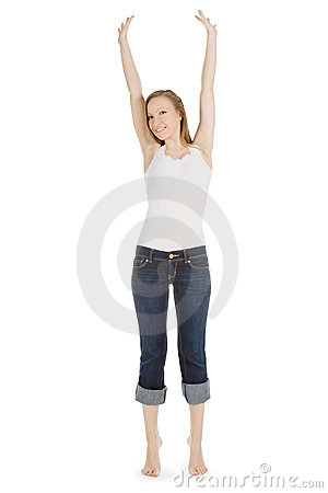 Carefree teenage girl in jeans over
