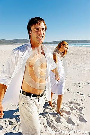 Carefree walking beach couple