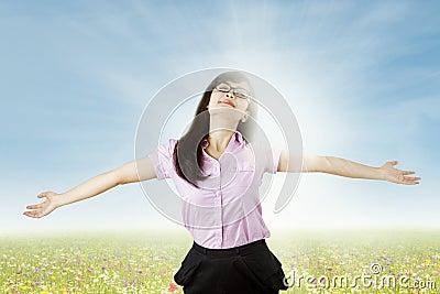 Carefree woman enjoying freedom outdoors