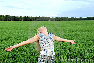 Carefree woman in green field