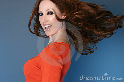 Carefree woman with long hair in motion