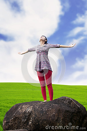 Carefree woman in meadow