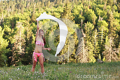 Carefree Woman Playing in the Wind