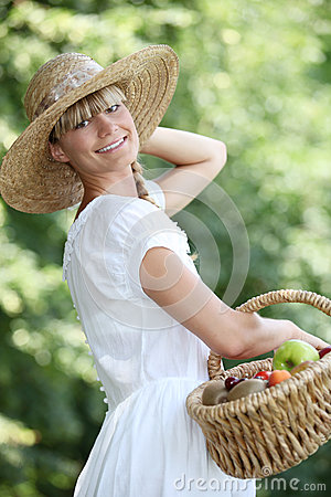 Carefree woman with a straw hat