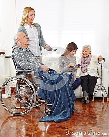 Caregiver entertaining senior