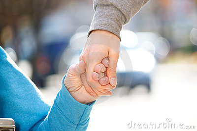 Caregiver Holding Senior s Hand