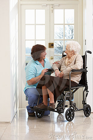 Carer With Disabled Senior Woman