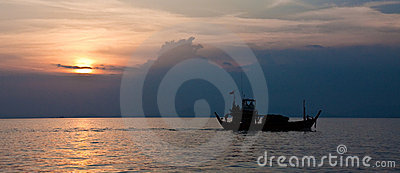 Cargo Boat at Sunset