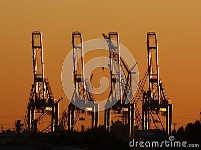 Cargo crane sunset