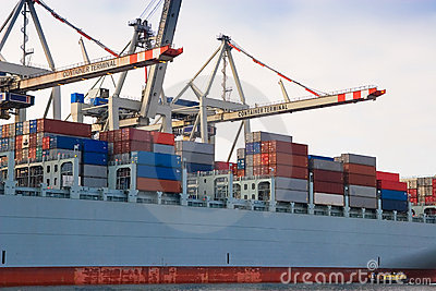 Cargo freight container ship at harbour terminal