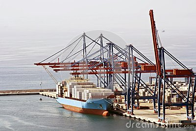 Cargo Ship in a port with cranes loading