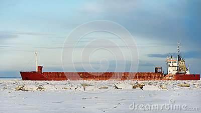 Cargo ship on the ice sea