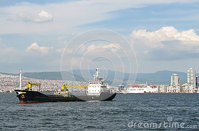 Cargo ship on Izmir background