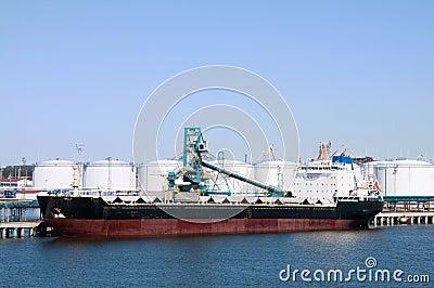 Cargo ship in port on loading