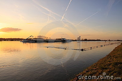 Cargo ship on river high water Editorial Stock Image
