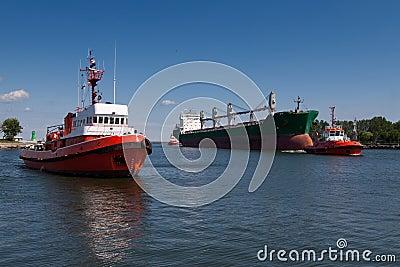 Cargo ship with tug